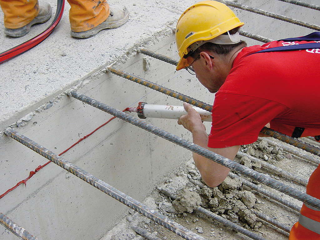 Man applying Sikaswell joint Waterproofing